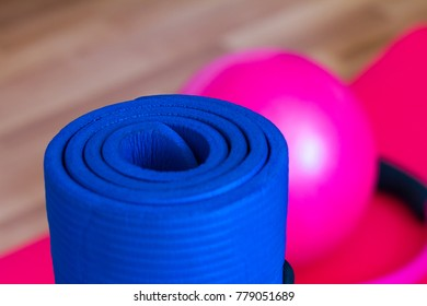 Close up view of blue pilates or yoga mat in pilates room, healthy life and sport concept.
