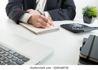 Close up view of bookkeeper or financial inspector hands making report, calculating or checking balance. Marketing strategy brainstorming. Paperwork and digital in office.