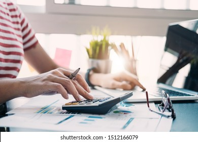 Close up view of bookkeeper or financial inspector hands making report, calculating or checking balance. Home finances, investment, economy, saving money or insurance concept