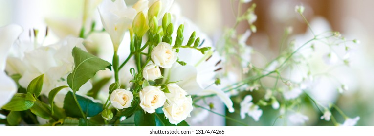 Close up view bouquet white roses lily on the glass, especial person or day, celebration, wedding, beautiful things created by nature concept, copyspace for your text flower shop advertising concept