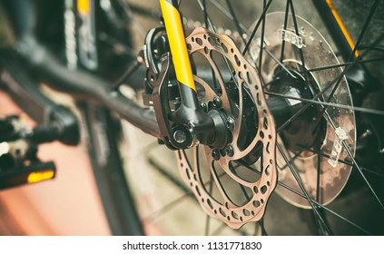 Close view of brake disk in good condition on the black bicycle