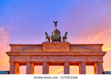 Close view of the Brandenburg Gate in Berlin at dusk, with colorful twilight in background, Berlin, Germany