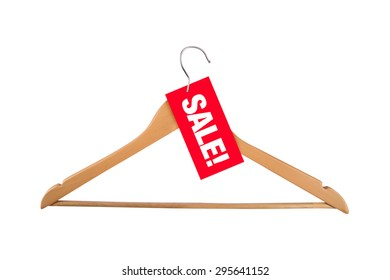 Close up view of brown wooden cloth hanger, label with sale text, isolated on white background.