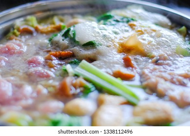 Close up view of bubble water in hotpot with meat vegetables. Shabu Shabu is style beef in hotpot dish of thinly sliced meat and vegetables boiled in water. delicious food most popular in Thailand.
