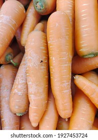 close up view a bunch of carrots on the table