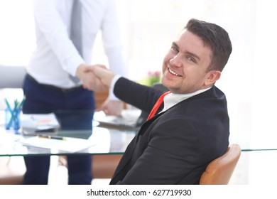 Close up view of business partnership handshake concept.Photo of two businessman handshaking process.Successful deal after great meeting.Horizontal,flare effect, blurred background