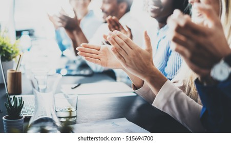 Close up view of business seminar listeners clapping hands. Professional education, work meeting, presentation or coaching concept.Horizontal,blurred background