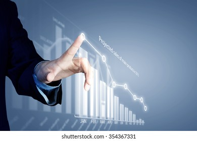 Close view of businessman touching screen with market infographs