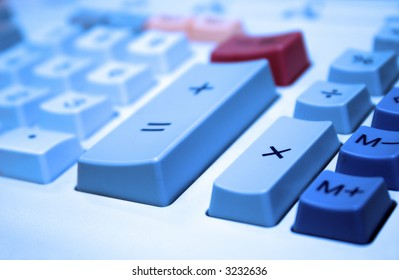 Close up view of calculator keys with the multiplication key in focus