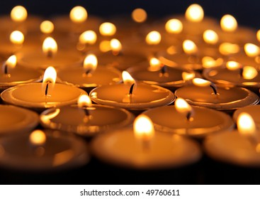 Close up view of the candles on dark background