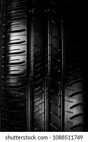 Close up view of a car tyre isolated on a black background