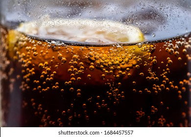 Close up view of carbonated drink bubbles with a lemon slice