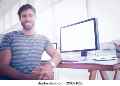 Close up view of a casual businessman smiling at the camera