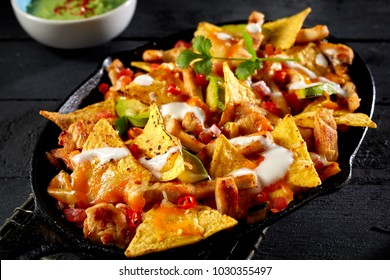 Close up view of chicken nacho tortilla with cream sauce