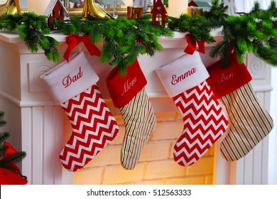 Close up view of Christmas stockings hanging on fireplace
