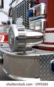 A close up view of a chrome siren on a fire truck