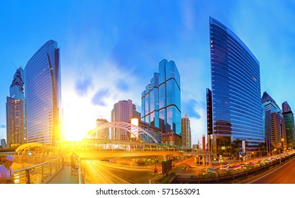 Close view Cityscape Modern building at sunset and cloudy sky.Traffic in the business district The Skytrain station Chong Nonsi,Bangkok,Thailand