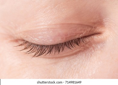 Close up view of a closed woman eye - no make up