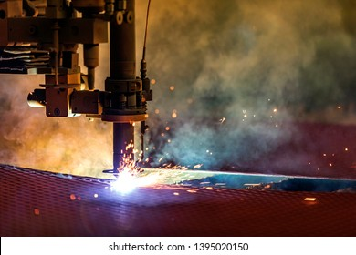 Close up view of the cnc plasma cutting. The basic plasma cutting process involves creating an electrical channel of superheated, electrically ionized gas.