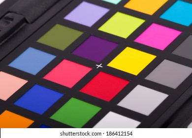 Close up view of color checker equipment of professional photographer for adjust and balance photograph.