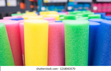 Close up view of colorful floating noodles. Plastic foam pool noodles. Background.