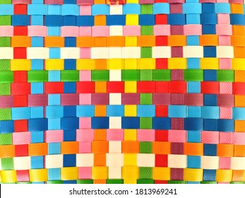 Close up view of colorful plastic woven basket texture background