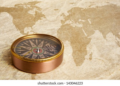Close up view of compass on vintage map