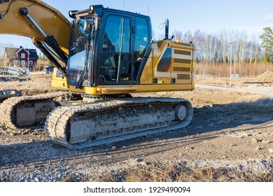 Close up view of construction excavator on outdoor construction place on spring blue sky background. Sweden.