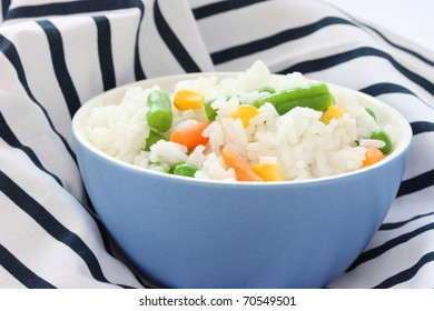Close up view of cooked rice in blue bowl - with mixed of colorful vegetable