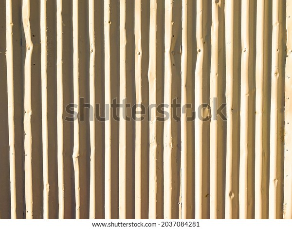 close view of a corrugated metal wall building structure