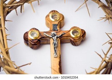 Close up view of Crown of thorns and wooden cross. Concept for faith, spirituality and religion.