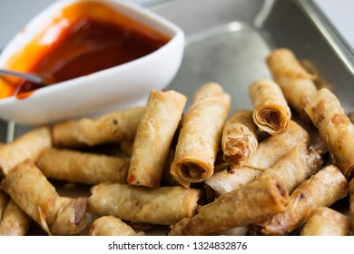 Close up view of delicious asian spring rolls with sauce