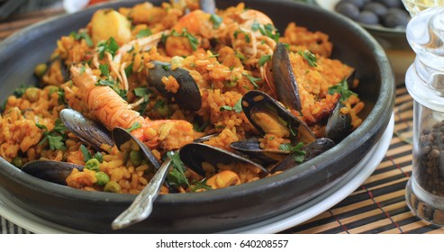 Close up view of delicious Spanish seafood paella: mussels, king prawns, langoustine, haddock