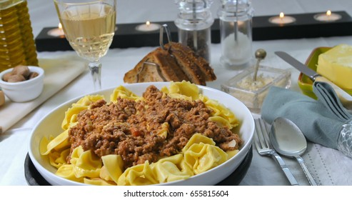 Close up view of delicious steamy tortellini in bolognese sauce (pasta)
