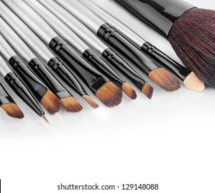 Close up view of different brushes on white back