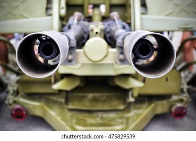a close view of double muzzles edge of artillery weapon unit