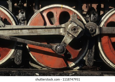 Close up view of drive gear of steam locomotive