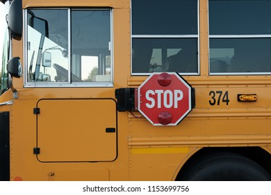 Close view of Drivers side of School Bus with STOP sign