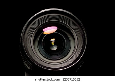 close up view of a DSLR lens in dark atmosphere