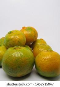 Close up view of eat jeruk kintamani bali oranges. Fruit epidemic, part of jeruk siam kepok pontianak, rich vitamin C, green orange color, little coarse textured fruit skin thick and hard to peel skin