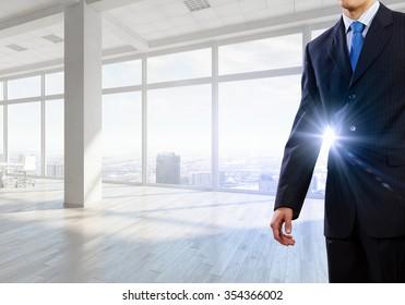 Close view of elegant businessman against modern ofiice window