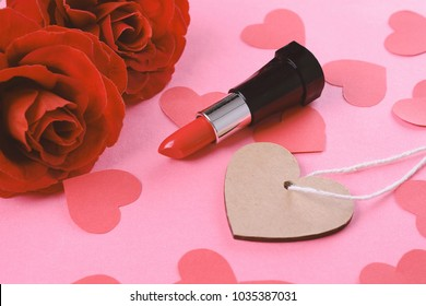 Close up view of empty heart card with red roses and lipstick. Mothers day concept