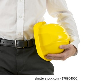 Close up view of a engineer carrying a yellow hardhat under his arm. Isolated over white, with copyspace.