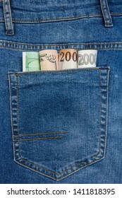 Close Up View to Euro, Dollar, Koruna, Forint Banknotes Sticking Out From a Blue Jeans Pocket