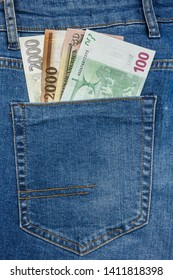 Close Up View to Euro, Koruna, Forint Banknotes Sticking Out From a Blue Jeans Pocket