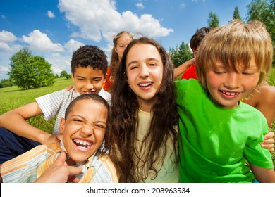 Close up view of excited kids in a group together