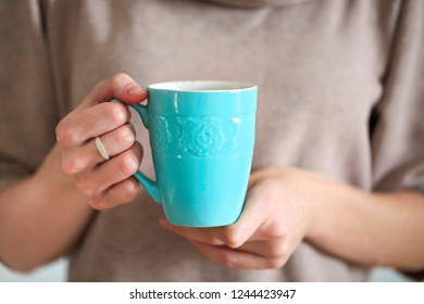 Close up view of female hands holding cup of freshly made cacao drink