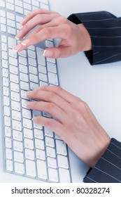 close up  view of female hands touching computer keyboard