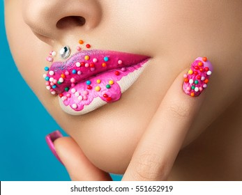 Close up view of female lips with sweet donut makeup. Fashion make up, dessert or junk food concept. Macro studio shot