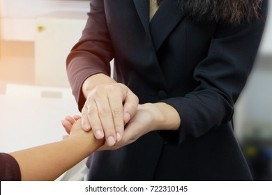 Close up view of female touching hand for encouragement, empathy, cheering, support , Trust concept.